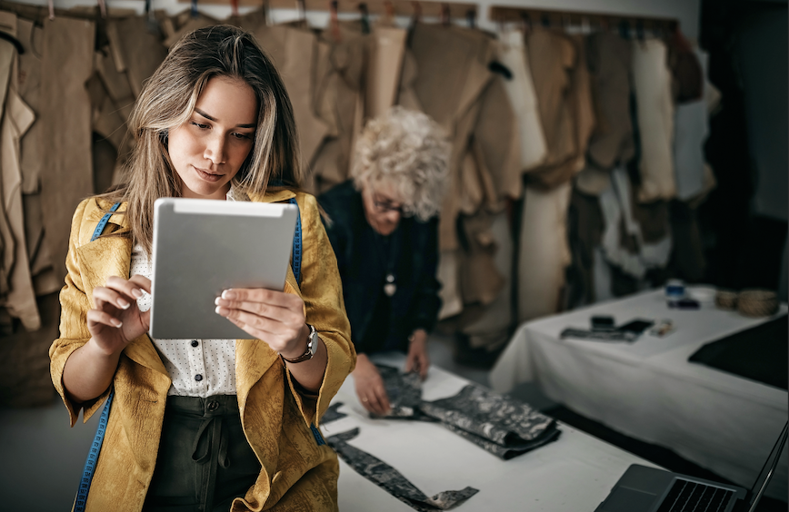 Woman checking her orders on tablet